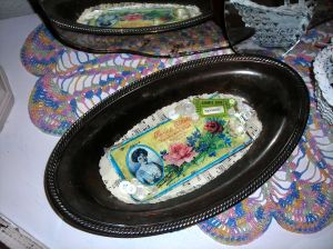 Cute silver tray adorned with lovelies! Sweet pink and blue crochet doily underneath made by my maternal grandma\'s hands