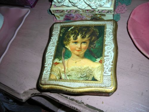 Found this precious thing (a musical jewelry box) for a buck at a Cove yard sale. I love the Victorian girl on it!