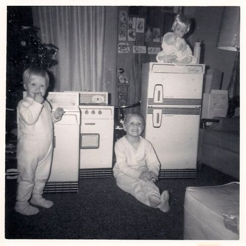 sisters with their new appliances. cardboard! and we loved them! cmas 1962
