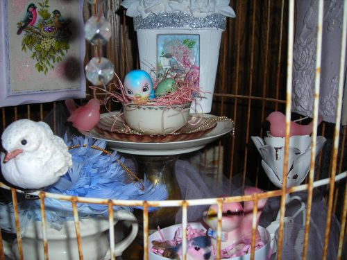 sweet little blue birdie and his friends! they have a fun time in there ... or so my demented mind likes to think.