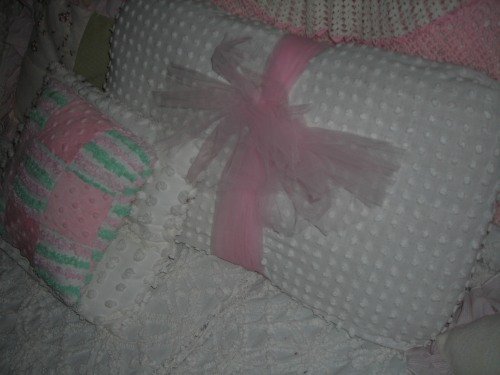 sweet pillow that i re-covered with an old piece of white chenille and wrapped up with some pink tulle